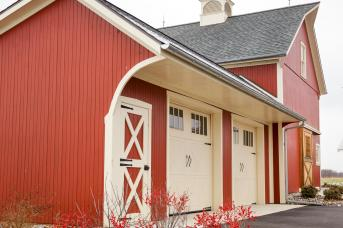 Stable Hollow Construction added the garage onto this restored barn.