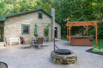 Back patio and hot tub at couple's cottage