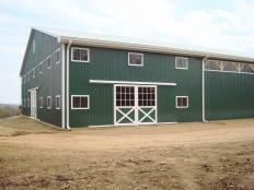 horse barn and arena by Stable Hollow Construction.